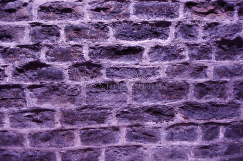 Gray cold brick wall stock photos