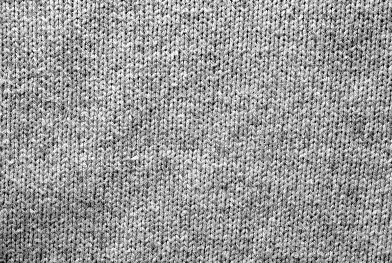 Gray color knitting pattern in black and white. royalty free stock photography