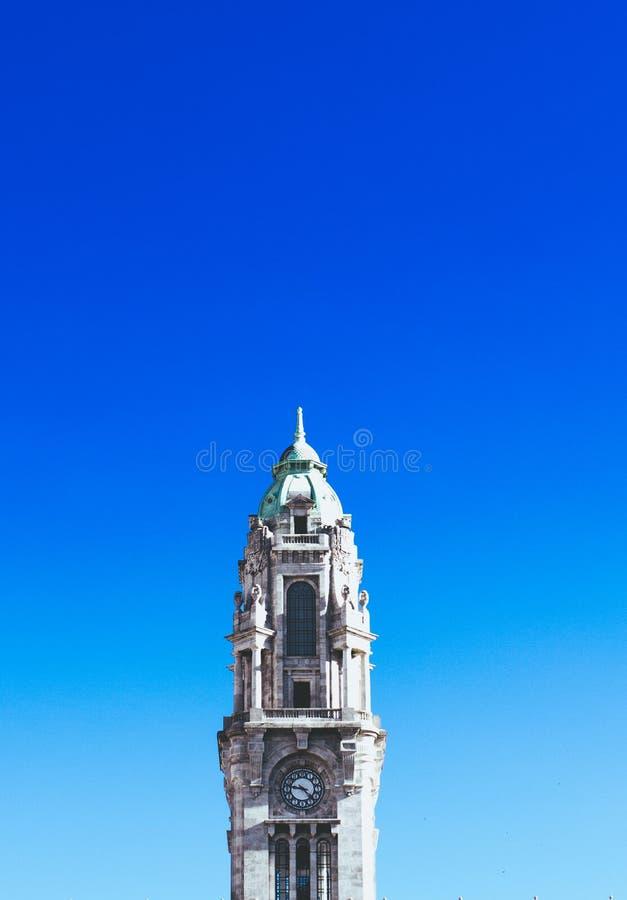 Gray Concrete Clock Tower Under Blue Sky stock photo