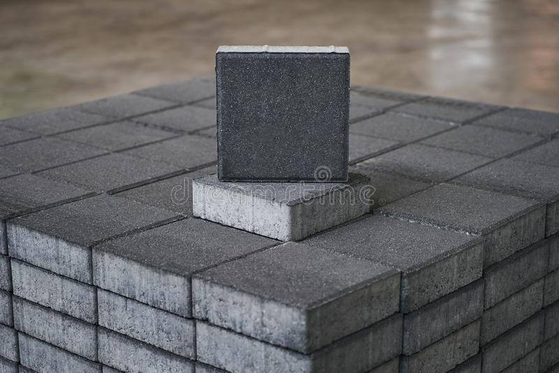 Gray Concrete road curbs at the factory warehouse. For the production of cement products, paving slabs. Industry manufacturing concept stock images