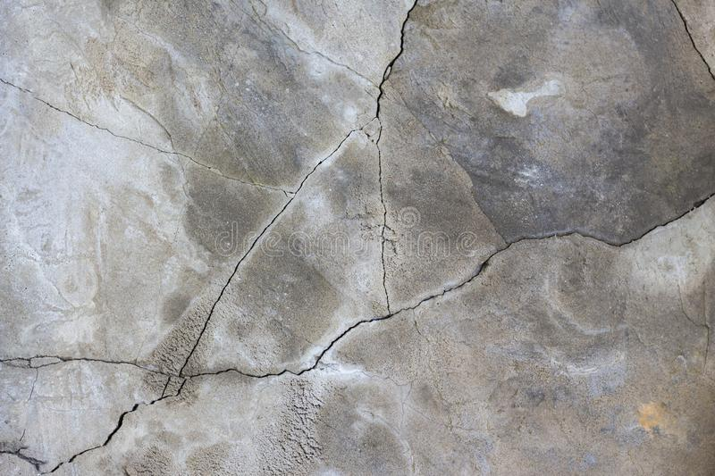 Gray concrete wall background with cracks graphic resource.  royalty free stock images