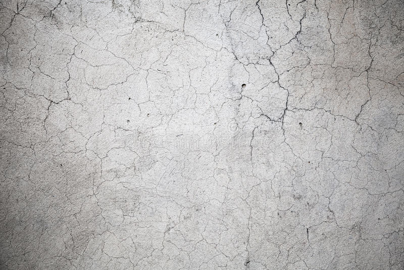 Gray concrete wall with cracks pattern. Background photo texture stock images