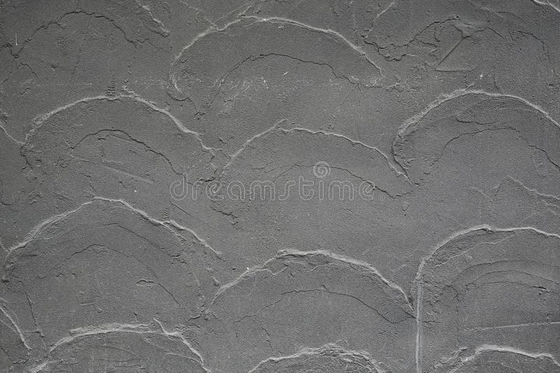 Gray concrete wall patched with plaster, Stucco relief pattern stock photos