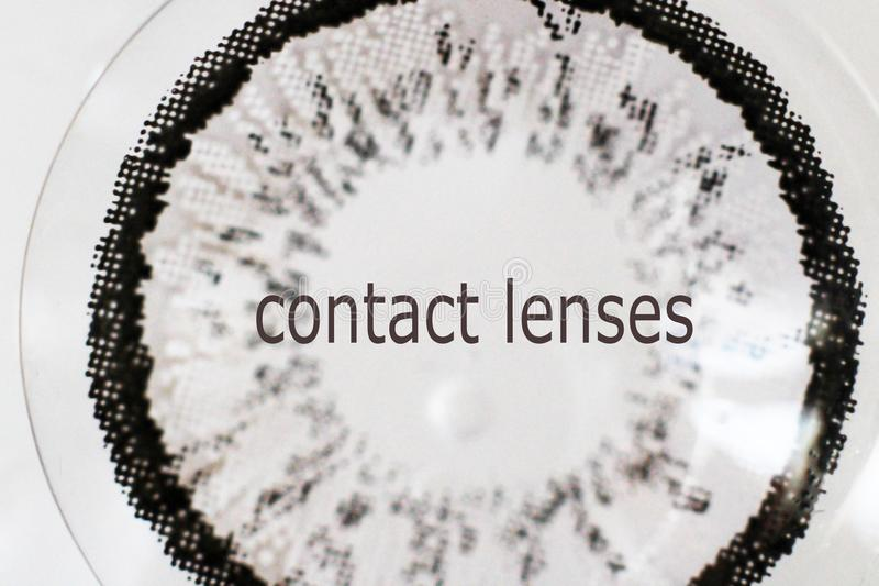 Gray contact lenses very close. Macro object stock photo