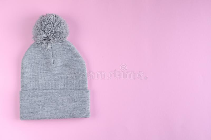 Gray cotton hat composition on pink background. Flat lay. Layout and tabletop mockup with copy space, above, flatlay, view, desk, frame, overhead, copyspace stock image