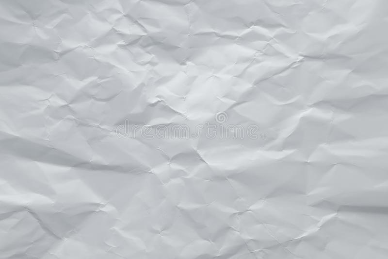 Gray crumpled paper background. Grey creased sheet page. Abstract rough texture, copy space. White wrinkled cardboard surface. stock images