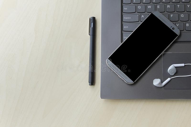 Gray and dark laptop and mobile phone for technology concept with copyspace. royalty free stock image