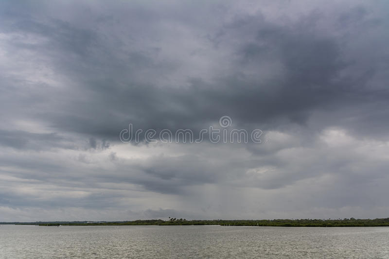 Gray day on the water royalty free stock photography