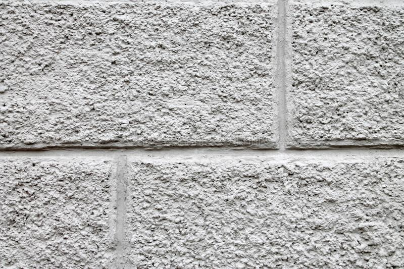 Gray decorative plaster on the facade royalty free stock photo