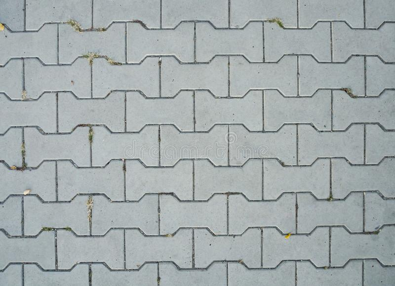 Gray decorative street tile background. Abstract texture. royalty free stock images