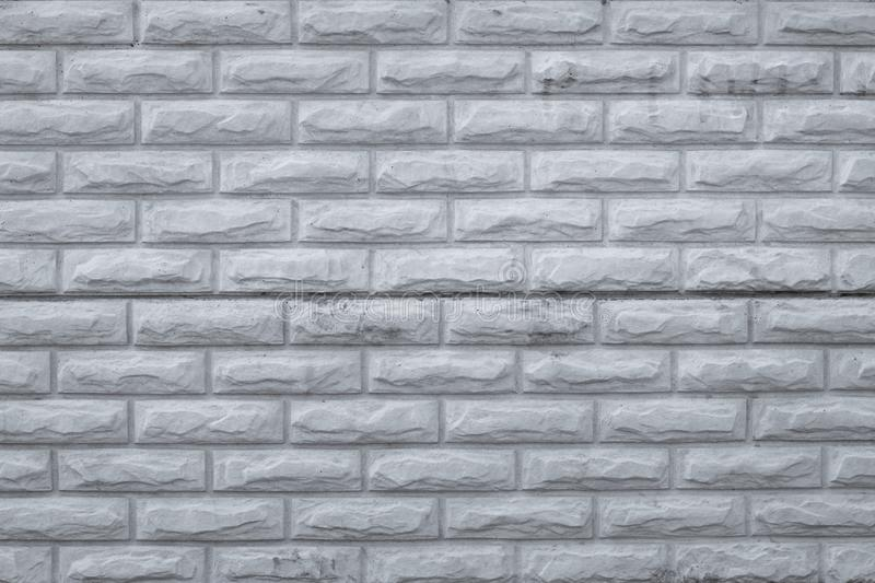 Gray dirty brick wall. Retro pattern with grey bricks wall, grunge background. Rough, vintage concrete texture, urban wall. Old ce royalty free stock photography