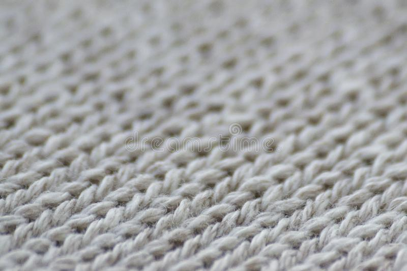 Gray fabric clothing texture close up. Blur background.  stock photography