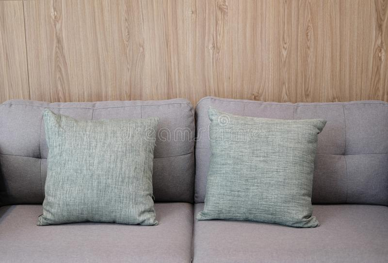 Gray fabric pillow on sofa couch furniture in living room. Gray fabric pillows on sofa couch furniture in living room stock photo