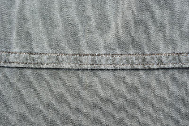 Gray fabric texture of a piece of cotton clothing stock image
