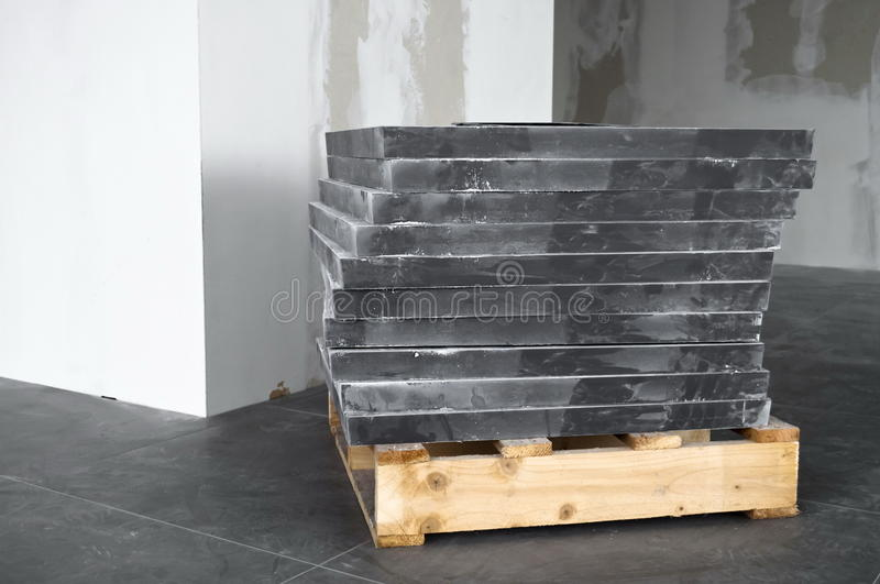Gray floor tiles. Under construction office with gray tiles floor posing stock photography