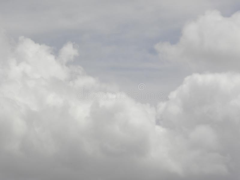 Gray fluffy clouds in sky stock photography