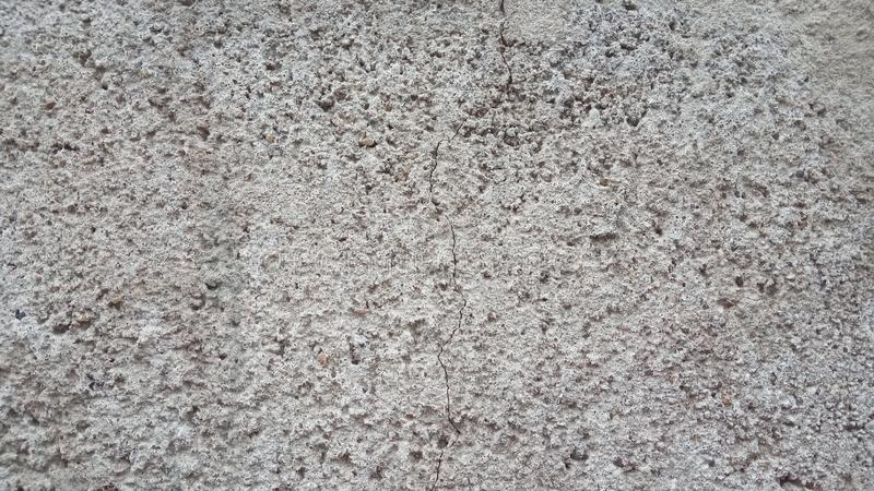 Gray grainy construction background. The surface of a concrete or aerated cinder cement block asphalt or wall.  royalty free stock image