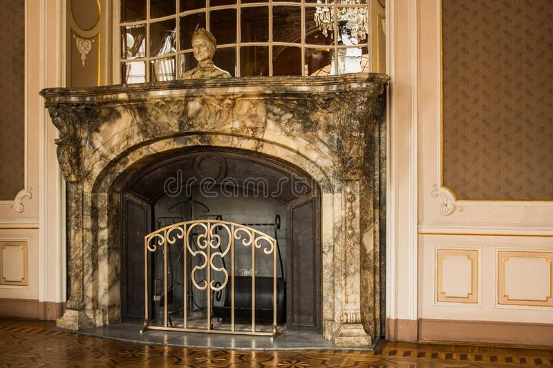 Gray granite stone fireplace in the luxury room of a rich mansion. interior of the hall. baroque style stock photos