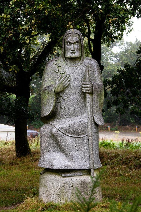 Gray granitowy posąg mężczyzny siedzącego obrazy royalty free