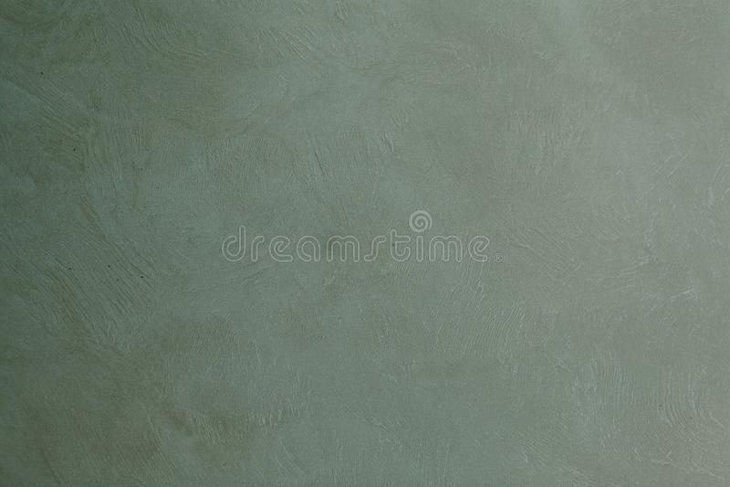 Gray green painted canvas or muslin fabric cloth studio backdrop.  stock photos
