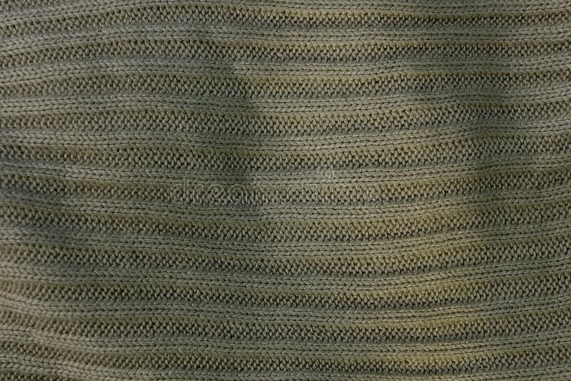 Gray green texture of crumpled cloth clothes. Gray green background of crumpled cloth clothes stock image