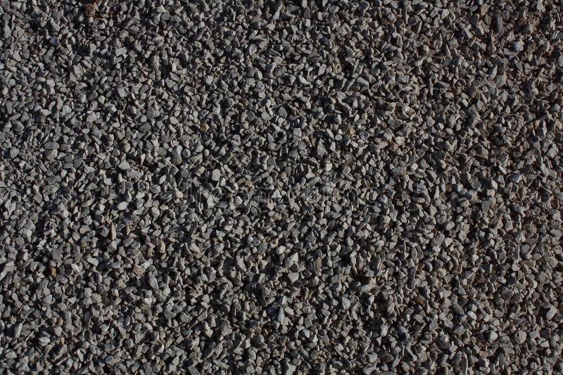 Gray grit. Background, small stones stock image