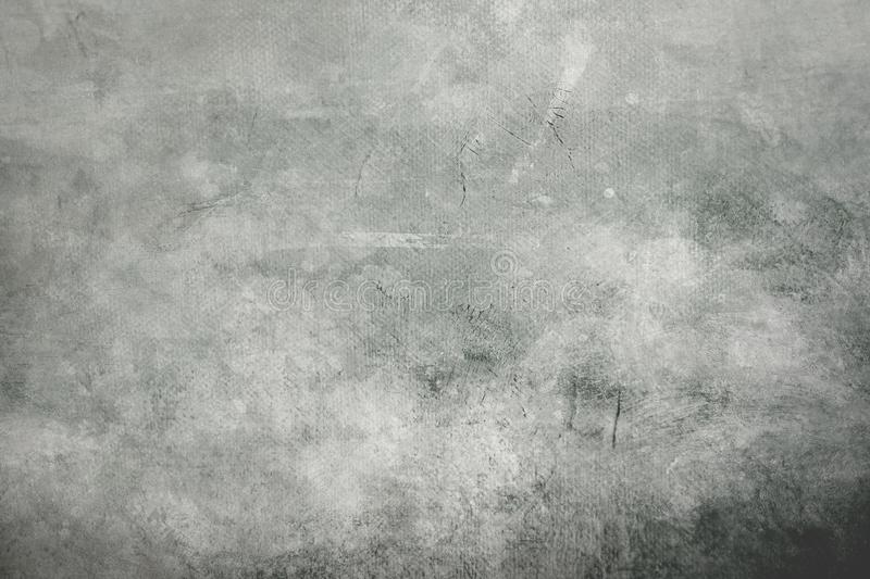 Gray grungy canvas background or texture with dark vignette borders. Gray abstract canvas background or texture with dark vignette borders royalty free stock photos