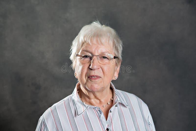 Gray hairy elderly friendly woman stock photo