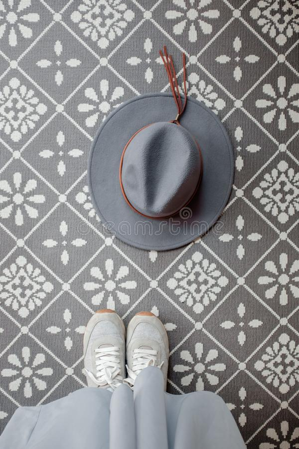 Gray hat on a patterned background royalty free stock photography