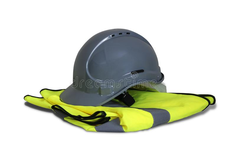 Gray helmet and yellow vest. Isolated on white background royalty free stock photo