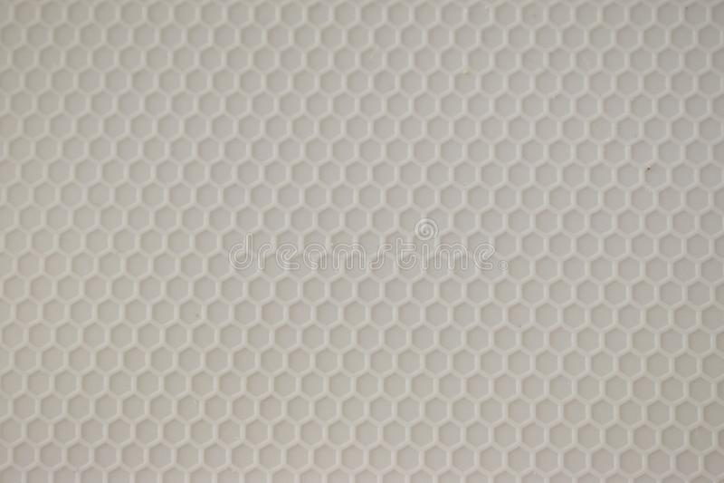 Gray Hexagon Pattern in geformtem Plastik stockfotografie