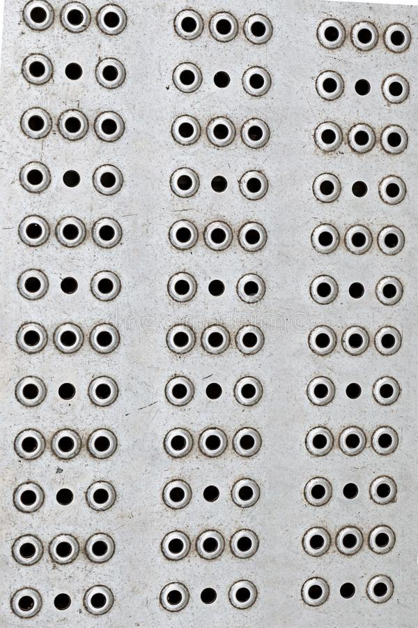 Gray hole background metal many round holes industrial design base vertical row hard texture royalty free stock photos