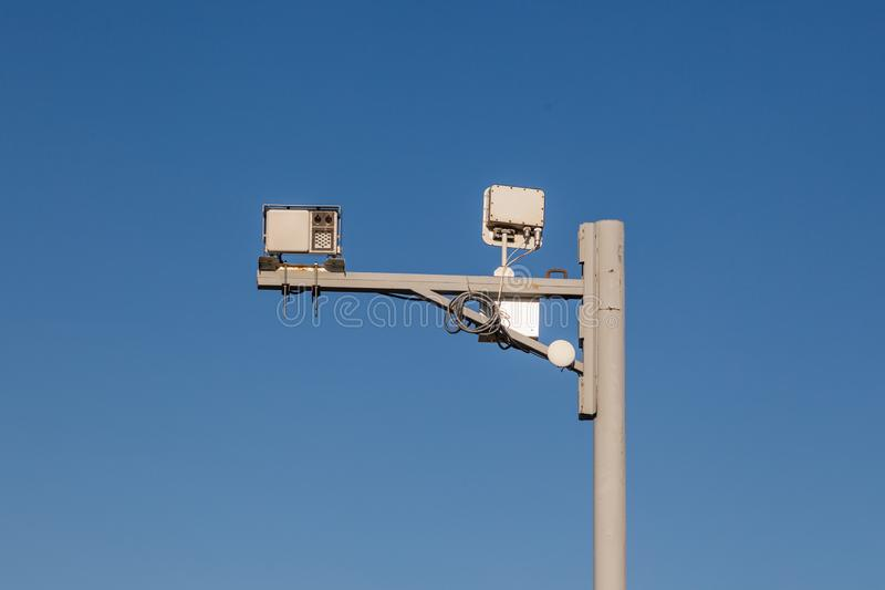 Gray iron pillar with surveillance cameras and speed control on stock photos