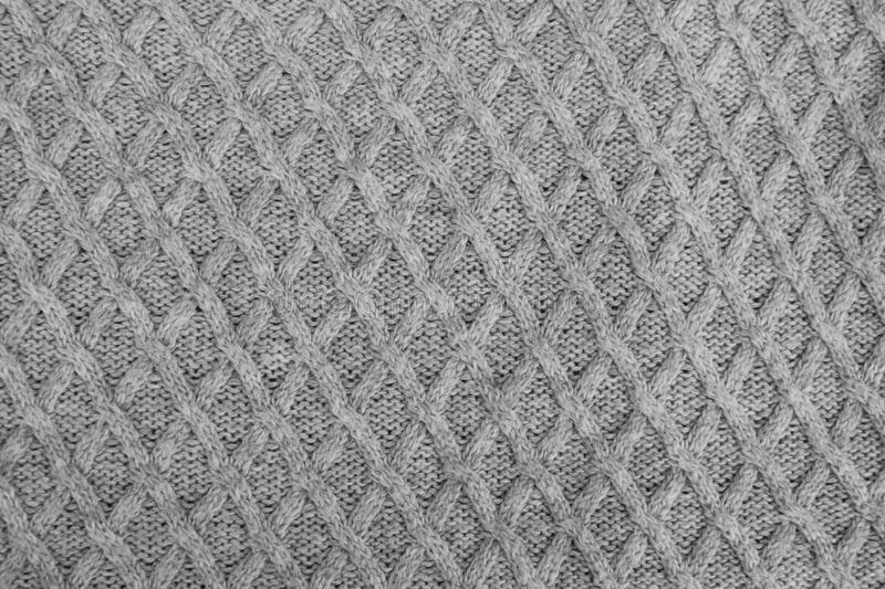 Gray knitting wool fabric pattern. As textured knitted background top view royalty free stock images