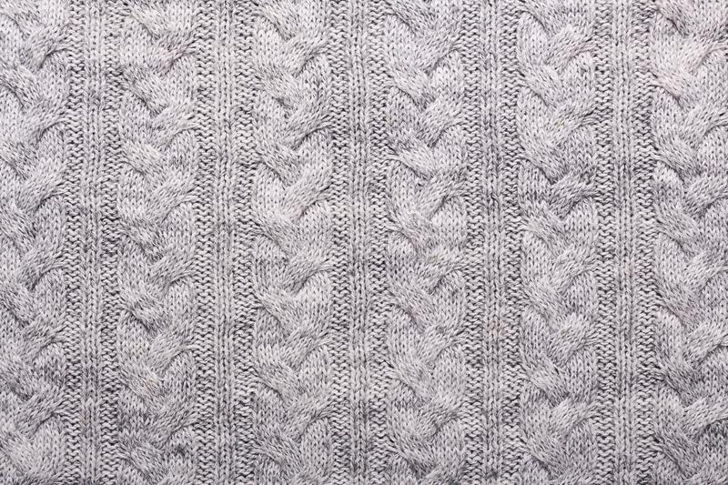Gray and lilac knitting wool texture background Crocheted fabric texture Top view Copy space. Gray and lilac knitting wool texture background Crocheted fabric royalty free stock photos
