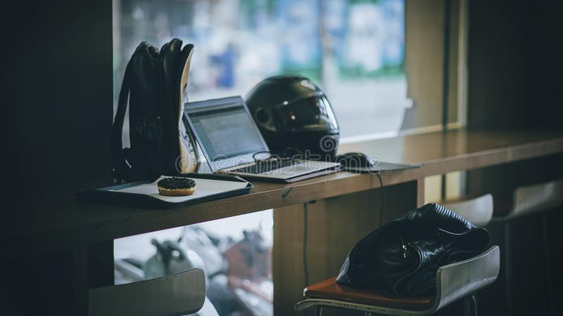 Gray Laptop Near Black Full-face Helmet royalty free stock image