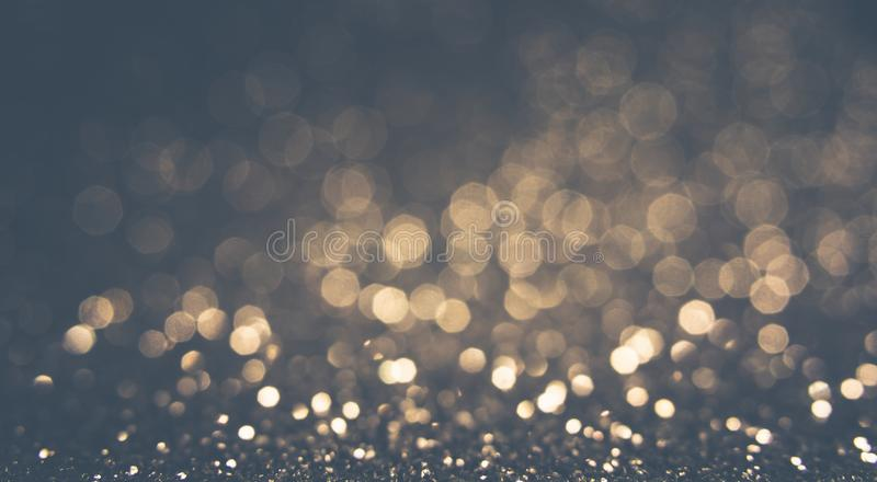 Gray lights and gray and yellow bokeh background for Valentine`s day, event and party concept. Golden background. Vintage stock photos