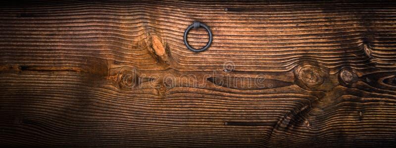 Gray Metal Door Knocker on Wooden Panel royalty free stock photos