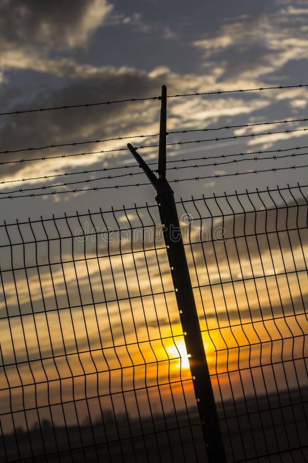 Gray Metal Fence during Sunset stock images