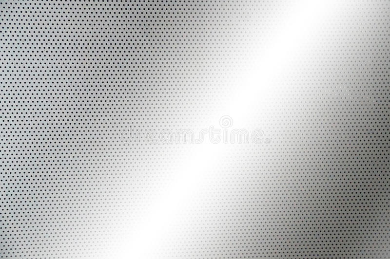 Gray metal plate with dots and screws royalty free stock photo