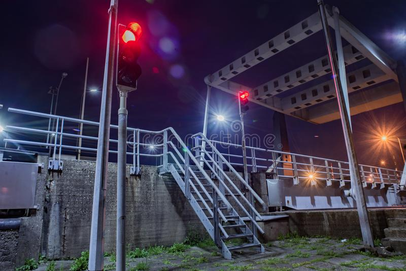 Gray Metal Stairs Near Road and Traffic Light royalty free stock photos
