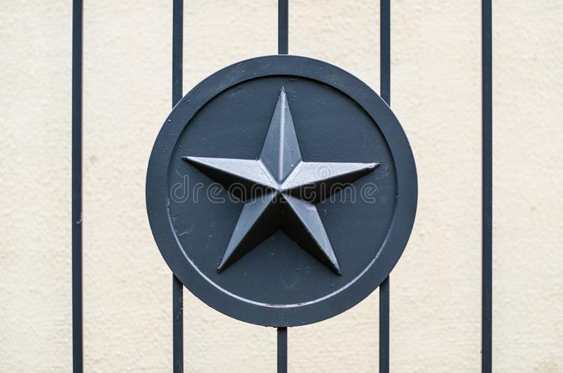 Gray metal star army military on metal fence gate.  stock images