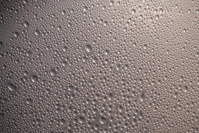 Gray metallic convex surface with bubbles. Brown texture of a shiny glass. Modern style of design. Abstract metal background. stock image