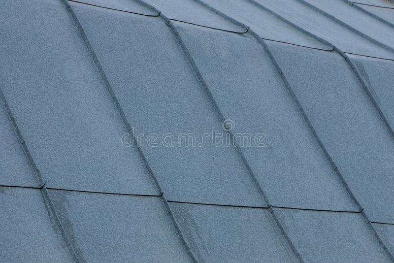 Gray metallic texture of zinc coating on the roof royalty free stock photos