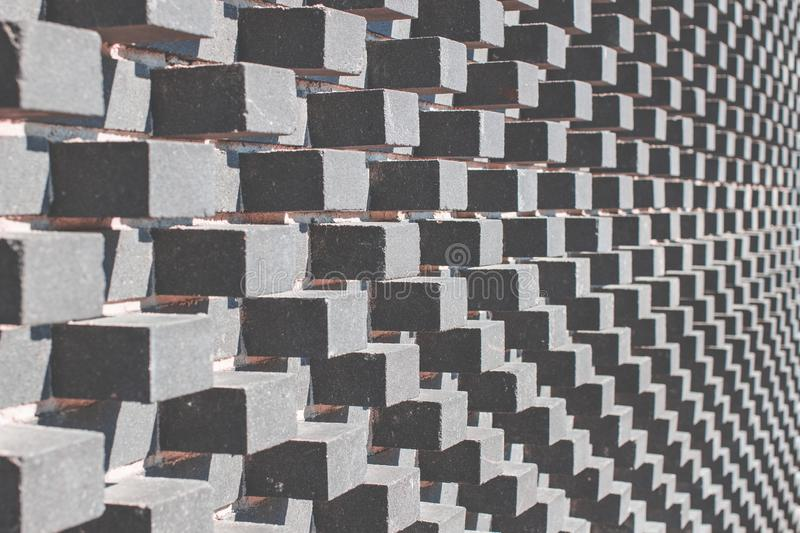 Gray modern architecture background with grey convex cubes on the wall royalty free stock photos