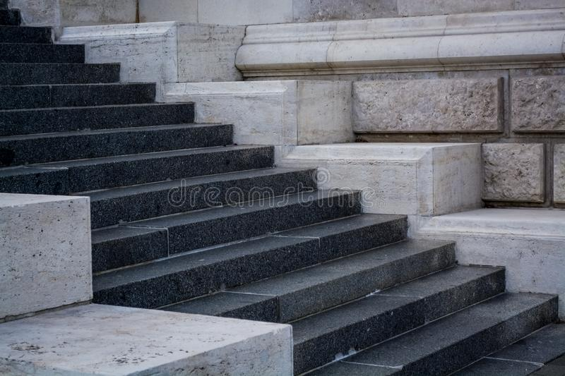 Gray and monophonic concrete steps. Stone walls. Old architecture. Background. stock photos