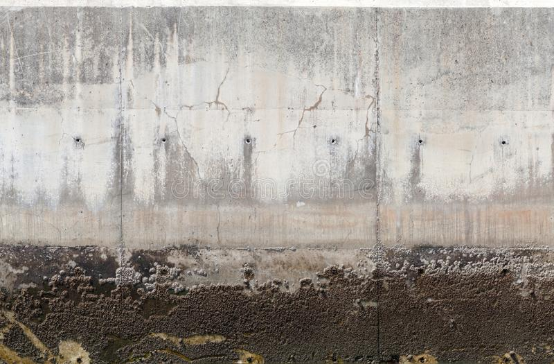 Gray mooring wall made of concrete. Background photo texture royalty free stock image