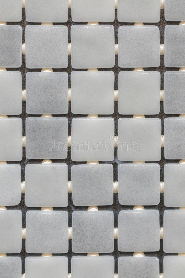Gray mosaic background. Silver Sequins Seamless Background. abstract seamless mosaic background. vertical photo.  royalty free stock photo