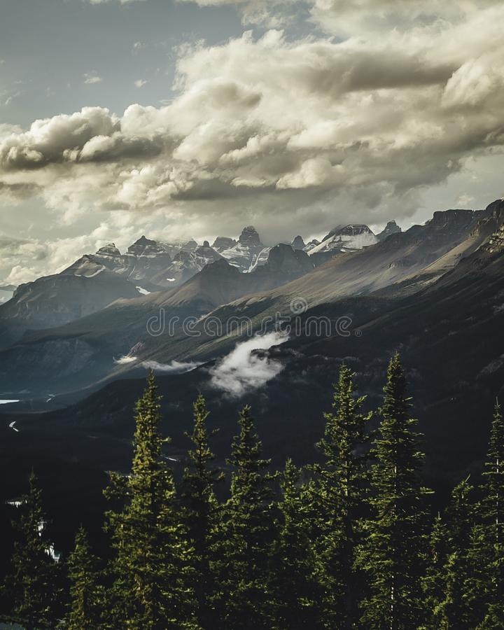 Gray Mountains Under Gray Sky at Daytime royalty free stock photography