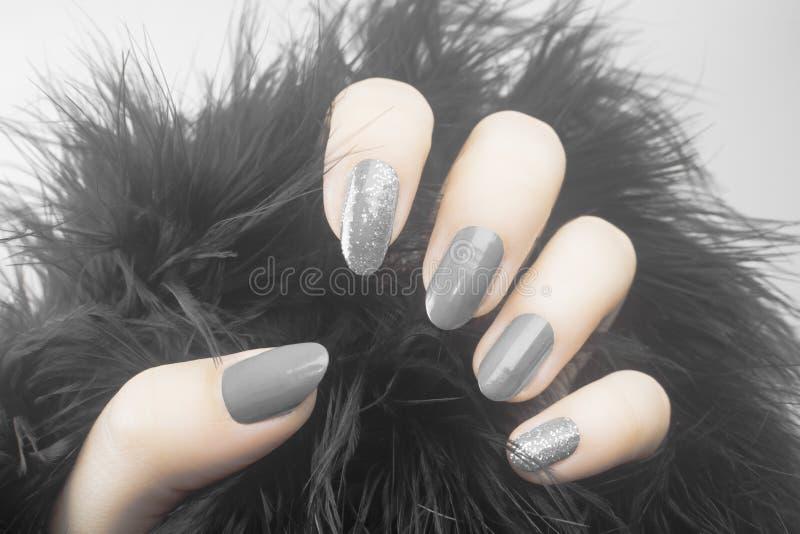 Gray nails manicure stock photos